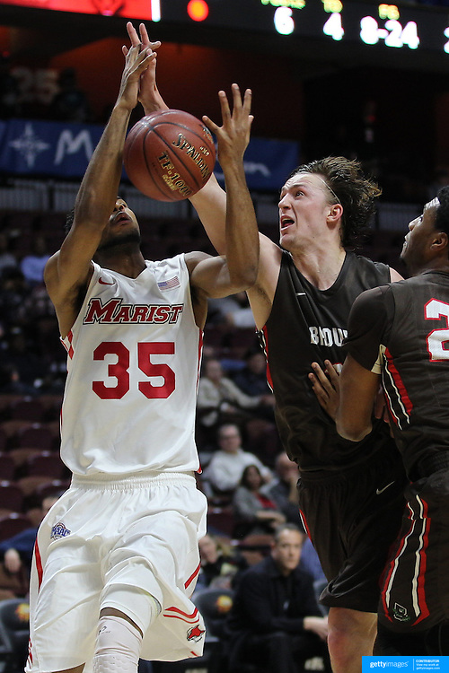 Steven Spieth, Brown, challenges for the rebound with Phil Lawrence-Ricks, Marist, during the Marist vs Brown Men's College Basketball game in the Hall of Fame Shootout Tournament at Mohegan Sun Arena, Uncasville, Connecticut, USA. 22nd December 2015. Photo Tim Clayton