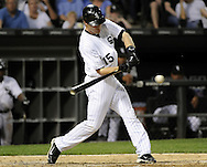 CHICAGO - JUNE 06:  Gordon Beckham #15 of the Chicago White Sox hits an RBI single in the seventh inning against the Seattle Mariners on June 6, 2011 at U.S. Cellular Field in Chicago, Illinois.  The White Sox defeated the Mariners 3-1.  (Photo by Ron Vesely)  Subject:  Gordon Beckham