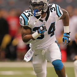 2008 December, 28: Carolina Panthers running back DeAngelo Williams (34) runs drills on the field prior to kickoff of a week 17 game between NFC South divisional rivals the Carolina Panthers and the New Orleans Saints at the Louisiana Superdome in New Orleans, LA.