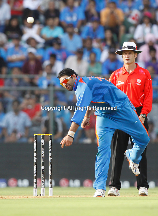 02.04.2011 Cricket World Cup Final from the Wankhede Stadium in Mumbai. Sri Lanka v India. Yuvraj Singh of India bolws during the final match of the ICC Cricket World Cup between India and Sri Lanka on the 2nd April 2011