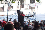 Tunis, Tunisia. January 26th 2011.A group of protesters chant slogans as one of them holds a riot police helmet and equipment after violent clashes with the police near government offices in the Casbah......