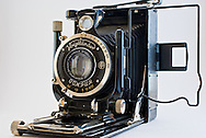 A 1920s Voigtlander Avus camera isolated on a white background. WATERMARKS WILL NOT APPEAR ON PRINTS OR LICENSED IMAGES.