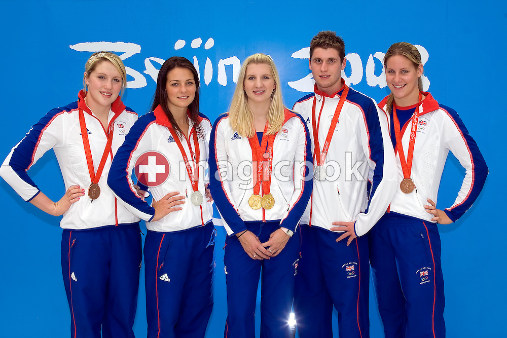 (L-R) Great Britain's swimming medalists Cassandra  PATTEN (3rd women's 10km marathon), Keri-Anne PAYNE (2nd women's 10km marathon), double Olympic champion Rebecca ADLINGTON (1st women's 400m and 800m freestyle), David DAVIES (2nd men's 10km marathon) and Joanne JACKSON (3rd women's 400m freestyle) pose with their medals in front of the 2008 Beijing Olympics logo at the National Aquatics Center at the Beijing 2008 Olympic Games in Beijing, China, Saturday, Aug. 23, 2008. (Photo by Patrick B. Kraemer / MAGICPBK)