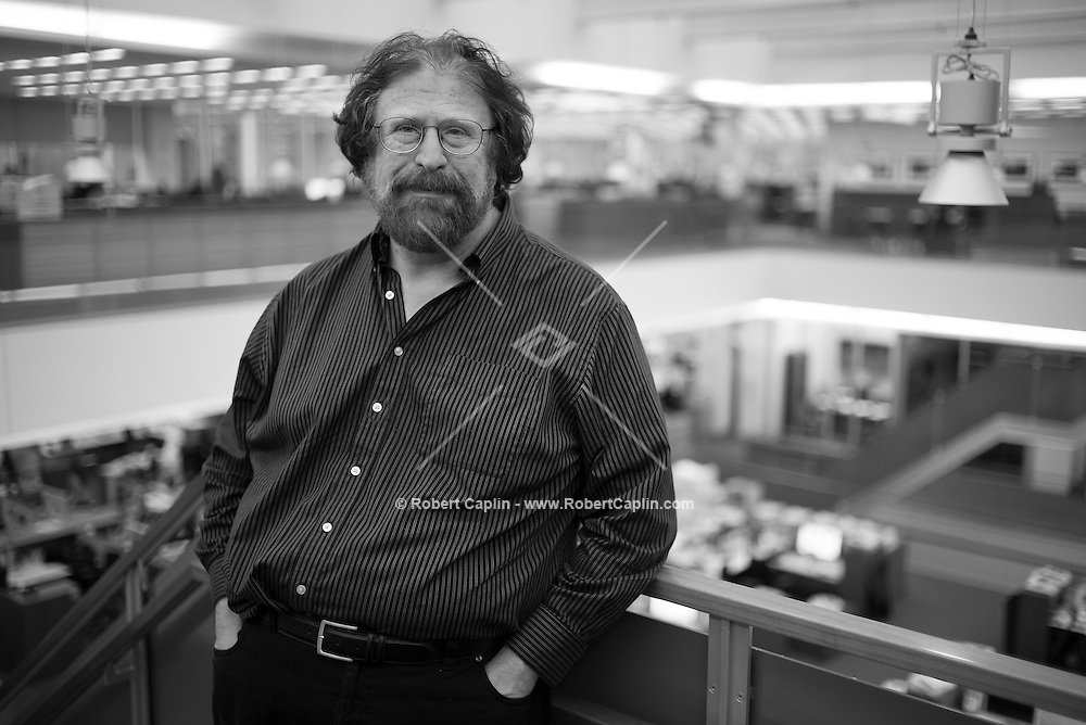 New York, NY (01.17.2014) New York Times photographer and co-editor of the LENS Blog, James Estrin, poses for a portrait at the New York Times offices in Manhattan. <br /> <br /> Photo by Robert Caplin