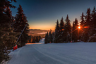 Perfectly maintained ski slope in the mountain at sunrise