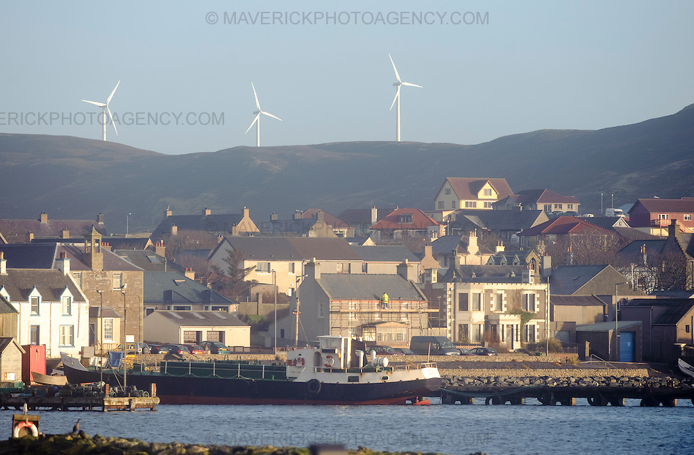 Wind turbines overlook the town of Scalloway - Scalloway, Shetland, Scotland, UK - 28th January 2009.