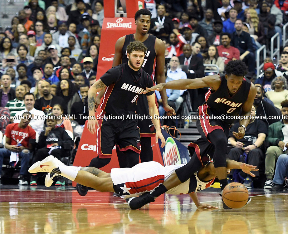 WASHINGTON, DC - APRIL 8: Miami Heat guard Josh Richardson (0) goes after a loose ball as Washington Wizards guard Bradley Beal (3) sprawls on the ground in the first half on April 8, 2017, at the Verizon Center in Washington, D.C.  The Miami Heat defeated the Washington Wizards 106-103.  (Photo by Icon Sportswire)