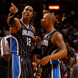 March 3, 2011; Miami, FL, USA; Orlando Magic center Dwight Howard (12) celebrates with shooting guard Quentin Richardson (5) following a win over the Miami Heat at the American Airlines Arena. The Magic defeated the Heat 99-96.    Mandatory Credit: Derick E. Hingle