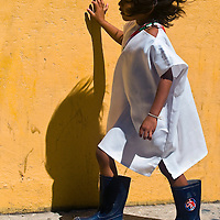 SANTA MARTA , COLOMBIA - DECEMBER 20 2010 : Indian girl walk in the street in Santa Marta , Colombia