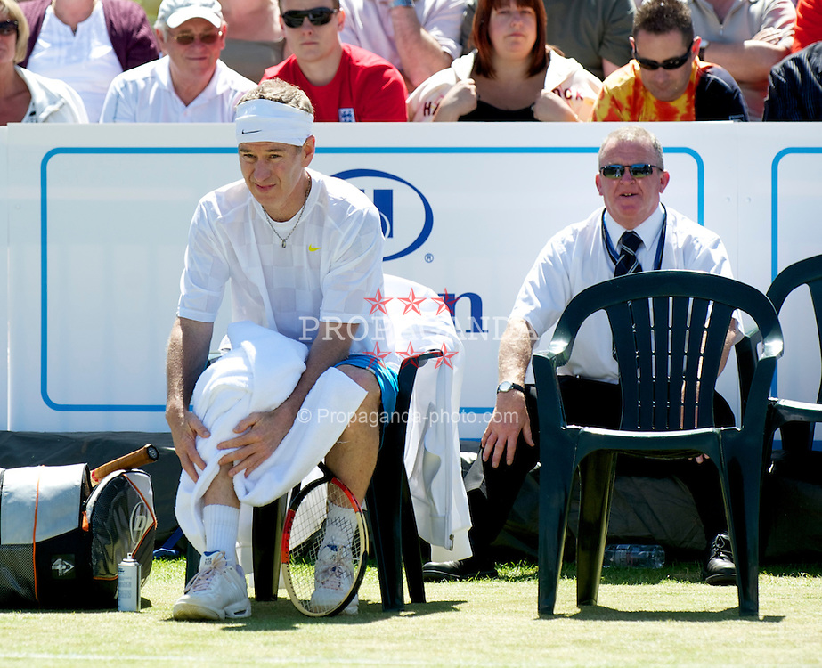 LIVERPOOL, ENGLAND - Sunday, June 20, 2010: John McEnroe (USA) with security on day five of the Liverpool International Tennis Tournament at Calderstones Park. (Pic by David Rawcliffe/Propaganda)