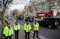 © Licensed to London News Pictures. 06/02/2017. London, UK. Police officers stand guard as a convoy of cars carrying  Israeli Prime Minister Benjamin Netanyahu arrives at Downing Street ahead of a meeting between Israeli Prime Minister Benjamin Netanyahu and British Prime Minister Theresa May. Photo credit: Ben Cawthra/LNP