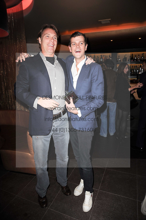 Left to right, DAMIAN ASPINALL and the HON.ALI SPENCER-CHURCHILL at a birthday party for Laurie Bilton held at Maddox Club, 2 Mill Street, London on 5th February 2010.