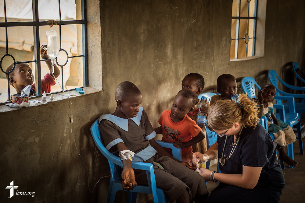 Sarah Kanoy, a career missionary in East Africa, treats a young patient at the LCMS Mercy Medical Team on Monday, June 20, 2016, in Nataparkakono, a village in Turkana, Kenya.  LCMS Communications/Erik M. Lunsford