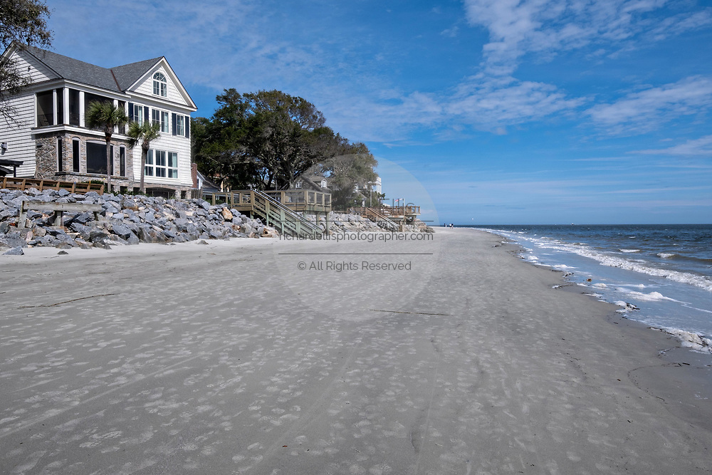 View of the beach front and homes at Coupers Point along the Saint Simons Sound in St. Simons Island, Georgia. The working lighthouse was built in first constructed in 1807 but destroyed by Confederate forces in 1862 before being rebuilt in 1872.