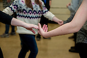 Students join hands while performing contradance in their mathematics for educators class on Friday, February 13. Their professor, Javier Ronquillo, combined the dancing with math to form a new way of learning.
