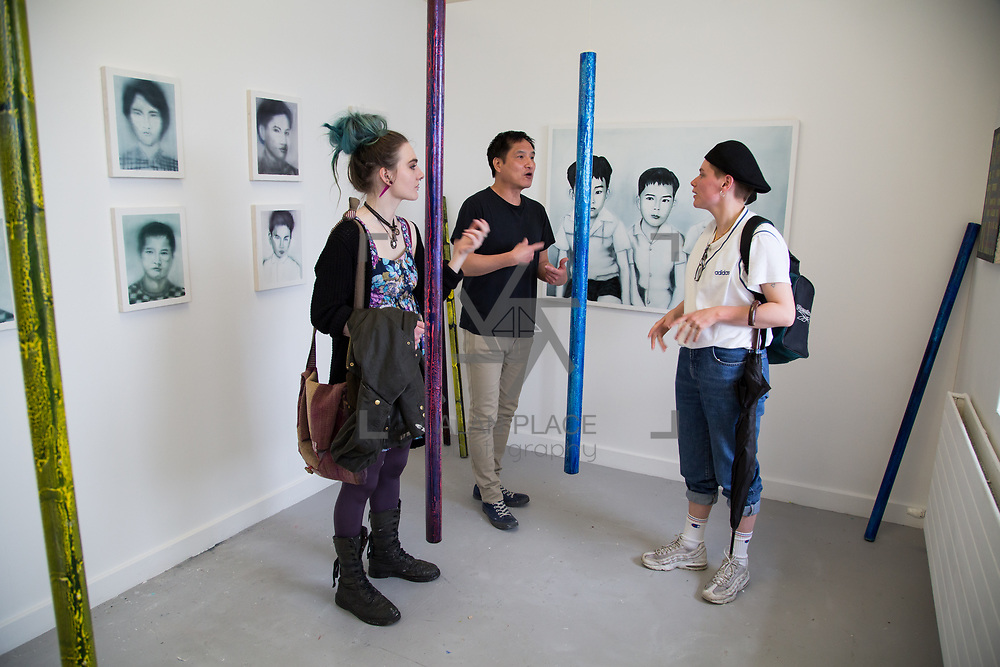 11.06.2017         <br /> International award winning artists are among the almost 200 graduates of Limerick School of Art and Design who's work went on exhibition at the LSAD Graduate Show 2017.<br /> <br /> Pictured is 4th year graduating Painting  student, Gary Kin-San Chan discussing his work titled 'The Binary Oppositions and The Myth of Sisyphus' with Olivia Robinson and Sinead Nix.<br />  <br /> Students from the college took control of the over-riding message of this historical show as they conceptualised, designed and delivered on the theme - be.cause.<br />  <br /> The hypothesis conceived by Graphic Design graduates Cassandra Walsh and David Reilly, is derived from the fact the graduates have now reached a stage where they are confident with their work, their interpretations and creative solutions. As creative minds they have an innate need to &ldquo;do&rdquo; something. There is just this need to create, be.cause.<br /> . Picture: Alan Place.