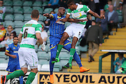 Tom Elliott of AFC Wimbledon battles Stephen Arthurworrey during the Sky Bet League 2 match between Yeovil Town and AFC Wimbledon at Huish Park, Yeovil, England on 12 September 2015. Photo by Stuart Butcher.