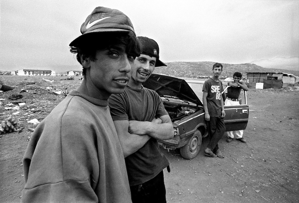The young men spend their days trying to restore old cars. There is no work for them in Podgorica. ..Konik camp - a refugee camp for Roma (gypsies) displaced from Kosovo, Montenegro