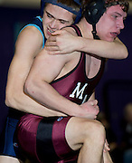 Jesse Hutchinson of Dirigo (left) competes in the 145-pound weight class championship match against Stewart Buzzell of Monmouth Academy at the Western Maine Regional Wrestling Championships at Bucksport High School on February 2, 2013.