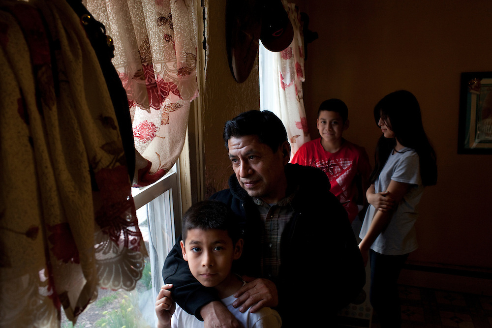 Vincent Vamos, also called Brojido Reyes by warehouse employer, with his children Harry Ramos, 9, Bruce Ramos, 12 and Nereyda Ramos, 13, in their home in New Brunswick, NJ on March 22, 2013..Across America, temp work has become a mainstay of the blue-collar economy, leading to the proliferation of ?temp towns? ? places where it's difficult to find work except through a temp agency and where workers suffer wage theft, no benefits and high injury rates, all for jobs that may end tomorrow for any reason.