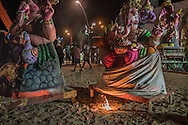 flame is set in front of one of many Ganesha statues from villages spread around the countryside outside Pondicherry that will be lifted by a crane and immersed in the Bay of Bengal to return to nature as part of the Ganesh Chaturthi Festival.  Pondicherry, India.