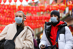 © Licensed to London News Pictures. 26/01/2020. London, UK.  A coupe in Chinatown in central London are seen wearing face masks following the outbreak of Coronavirus in China which has killed 41 people. Photo credit: Dinendra Haria/LNP