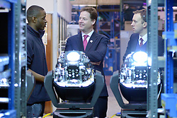 © Licensed to London News Pictures. 14/03/2013. London, UK Deputy Prime Minister Nick Clegg (centre) and Skills Minister Matthew Hancock (Right) talk to Jamal Peters (Left), an apprentice, whilst he services theatrical lighting at the company. Deputy Prime Minister Nick Clegg visits White Light, a company in South West London, to talk to apprentices and launch the Government's response to the Richard Review today 14th March 2013. Photo credit : Stephen Simpson/LNP