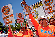 May 29 - PHOENIX, AZ: Union members who support immigrants' rights at a march at the Arizona State Capitol Saturday. More than 30,000 people, supporters of immigrants' rights and opposed to Arizona SB1070, marched through central Phoenix to the Arizona State Capitol Saturday. SB1070 makes it an Arizona state crime to be in the US illegally and requires that immigrants carry papers with them at all times and present to law enforcement when asked to. Critics of the law say it will lead to racial profiling, harassment of Hispanics and usurps the federal role in immigration enforcement. Supporters of the law say it merely brings Arizona law into line with existing federal laws.  Photo by Jack Kurtz