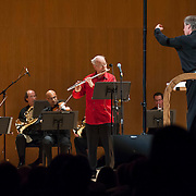 """June 8, 2012 - New York, NY : David Robertson, standing at right, conducts the New York Philharmonic in Pierre Boulez's """"...explosante-fixe..."""" (1991-93), with computer music design, production, and sound engineering by IRCAM, during The Metropolitan Museum of Art's Presentation of """"CONTACT!,"""" the new-music series of the New York Philharmonic, on Friday night. The piece featured Robert Langevin on MIDI-flute (wearing red). CREDIT: Karsten Moran for The New York Times"""