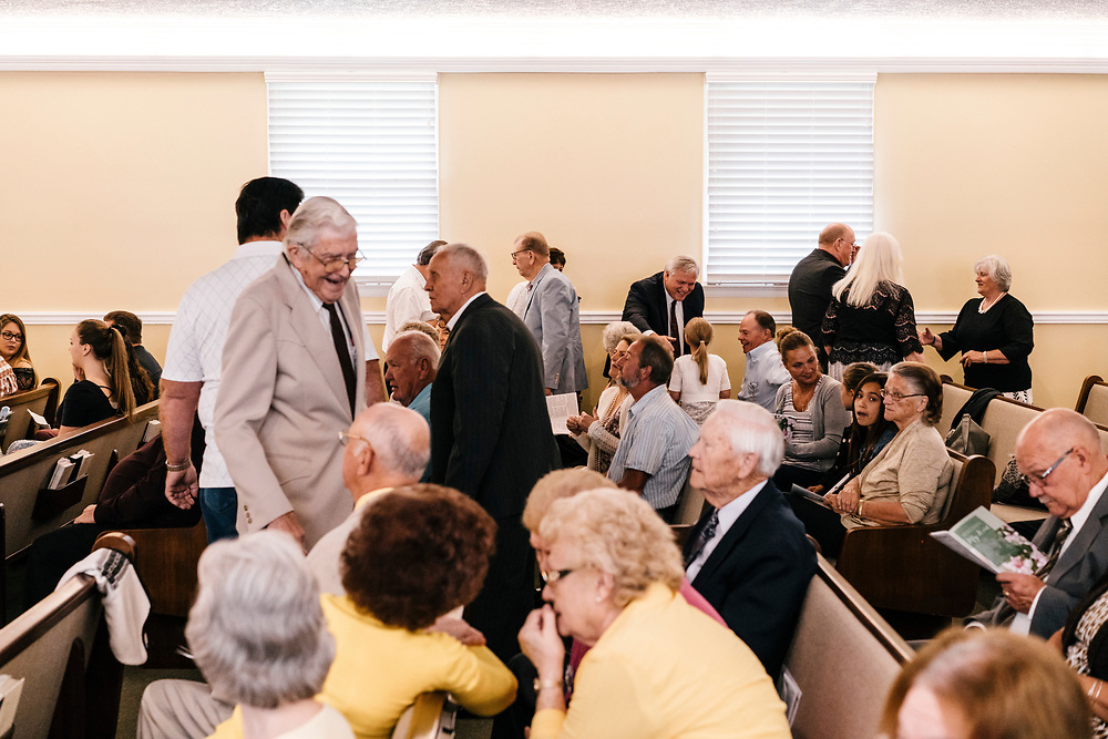 Church members greet each other before service at Full Gospel Pentecostal Church in Martinsburg, WV on June 4, 2017.
