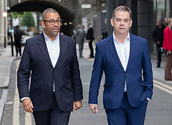 © Licensed to London News Pictures. 15/06/2019. London, UK. Conservative Party MPs James Cleverly (L) and Nigel Adams leave a leadership hustings event in central London. The remaining candidates in the leadership race will face a second round of votes in Parliament on Tuesday next week. Photo credit: Peter Macdiarmid/LNP
