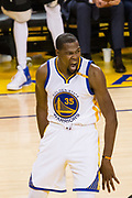 Golden State Warriors forward Kevin Durant (35) celebrates a dunk against the Utah Jazz during Game 2 of the Western Conference Semifinals at Oracle Arena in Oakland, Calif., on May 4, 2017. (Stan Olszewski/Special to S.F. Examiner)
