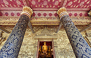 Laos. Luang Prabang. Buddha statue and gold reliefs at Wat Mai.
