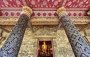 Laos. Luang Prabang. Buddha statue and gold reliefs at Wat Mai.