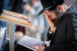 19 April 2019, Jerusalem: A Jewish man cries by the Western Wall. On the first day of Pesach (Passover) Jews gather to pray by the Western Wall in Jerusalem, considered as the most sacred and holy place for the Jews.