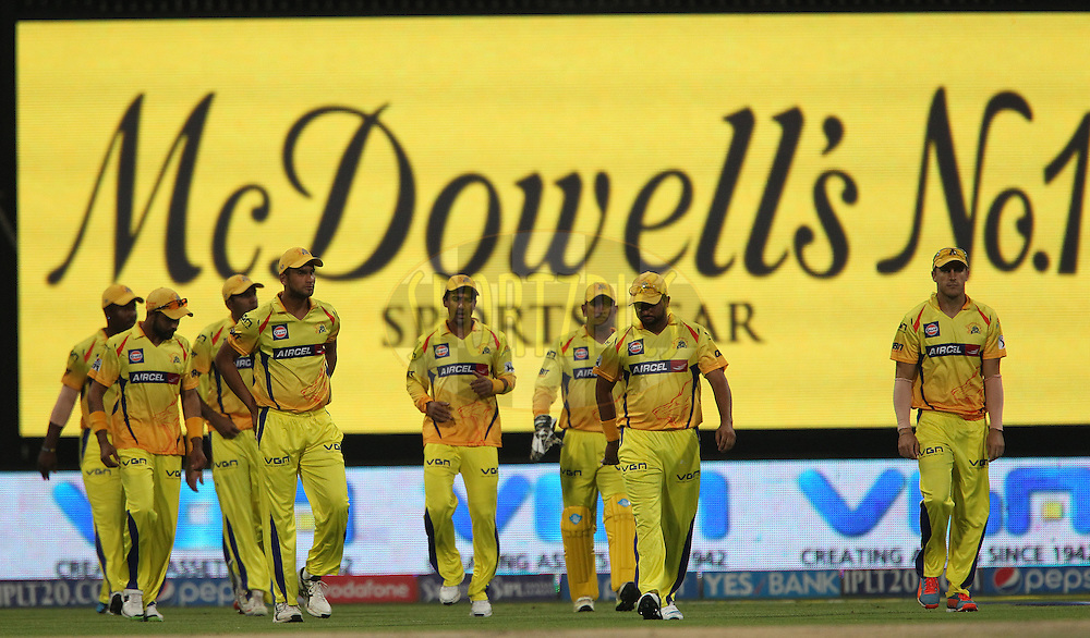 MS Dhoni captain of The Chennai Superkings leads CSK onto the field during match 8 of the Pepsi Indian Premier League 2014 between the Chennai Superkings and The Delhi Daredevils held at the Zayed Cricket Stadium, Sharjah, United Arab Emirates on the 21st April 2014<br /> <br /> Photo by Ron Gaunt / IPL / SPORTZPICS