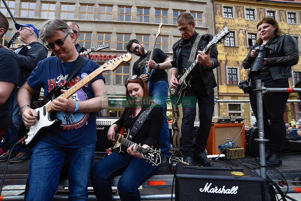 May 1, 2019 - Wroclaw, Poland - A mass gathering of guitarists seen attempting  to beat the Guinness record for ensemble guitar playing at the Main Square. According to the organizer, reports say 7243 musicians gathered in Wroclaw Market Square to play Jimi Hendrix's hit 'Hey Joe.' (Credit Image: © Omar Marques/SOPA Images via ZUMA Wire)