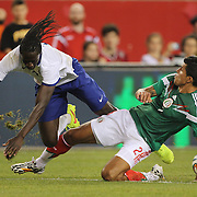Éder, (left), Portugal, is tackled by Francisco Rodríguez, Mexico, during the Portugal V Mexico International Friendly match in preparation for the 2014 FIFA World Cup in Brazil. Gillette Stadium, Boston (Foxborough), Massachusetts, USA. 6th June 2014. Photo Tim Clayton