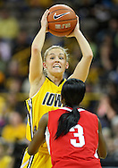 January 08 2010: Iowa guard Kamille Wahlin (2) looks to pass over Ohio St. guard Amber Stokes (3) during the first half of an NCAA womens college basketball game at Carver-Hawkeye Arena in Iowa City, Iowa on January 08, 2010. Iowa defeated Ohio State 89-76.