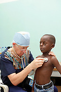Pediatrician Yves De Clerk examines patients one at a time in the pre op ward...Operation Smile South Africa.Clinique Ngaliema, Avenue Des Cliniques.KInshasa, DRC Mission, June 3rd-12th 2011..© Zute & Demelza Lightfoot.www.lightfootphoto.com...