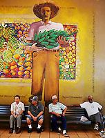 Puerto Ricans sit along benches in a market, San Juan, Puerto Rico, on Friday, November 14, 2008.