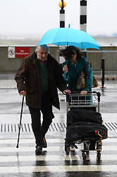 A couple battle the wind and rain as they make their way into Heathrow's Terminal 5 to get away for Christmas.<br /> Christmas travellers leave for their festive holidays at Heathrow Airport. Monday, 23rd December 2013. Picture by Ben Stevens / i-Images