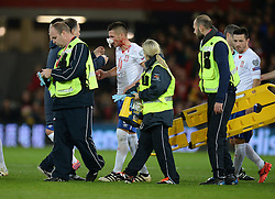Dusan Tadic of Serbia is lead off the pitch after bloody pours from his nose. - Mandatory by-line: Alex James/JMP - 12/11/2016 - FOOTBALL - Cardiff City Stadium - Cardiff, United Kingdom - Wales v Serbia - FIFA European World Cup Qualifiers