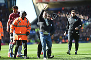 Apitch invader is escorted from the pitch after assaulting Aston Villa midfielder Jack Grealish (10) during the EFL Sky Bet Championship match between Birmingham City and Aston Villa at St Andrews, Birmingham, England on 10 March 2019.