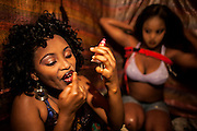 Young prostitutes, aged 14 and 16 years, are getting ready to go to work in bars and night clubs. During the day sharing a hovel to sleep at night rent beds for clients. Prices for renting are almost 60-70 birr per day (2.40 - 2.50 €)<br /> <br /> Addis Ababa, Ethiopia, 17-12-2012.<br /> <br /> To protect the identities of the recorded subjects names are omitted