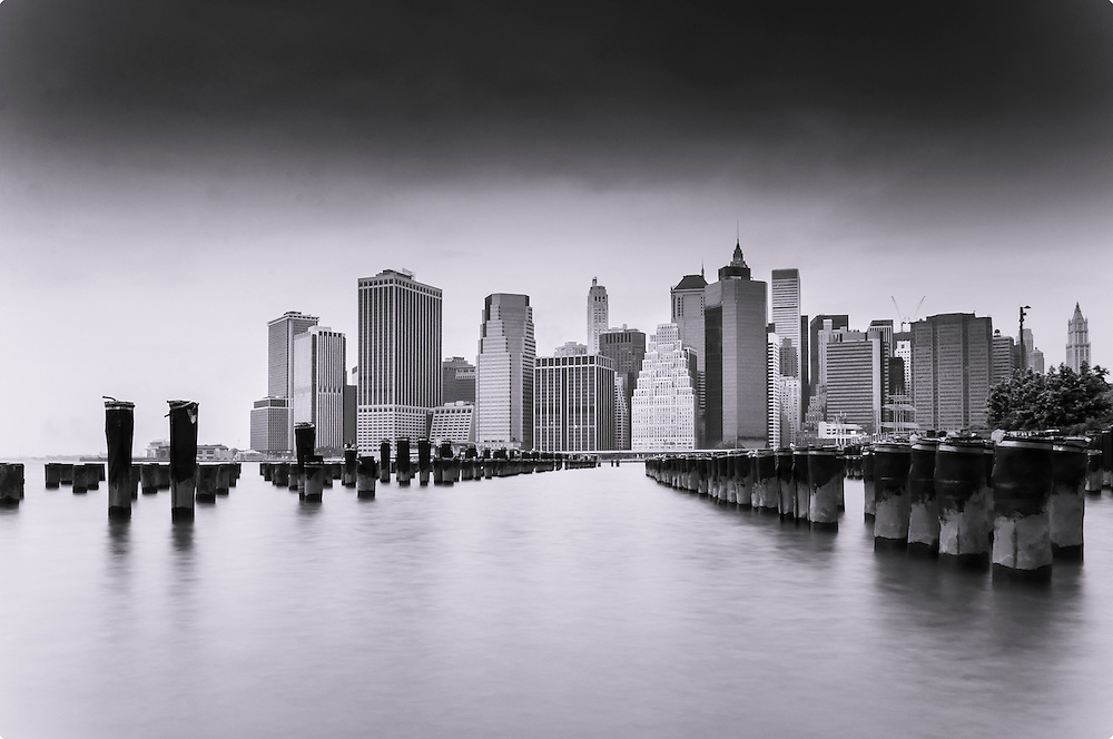 A long exposure photo of the Manhattan skyline taken from the Brooklyn Bridge Park, Brooklyn