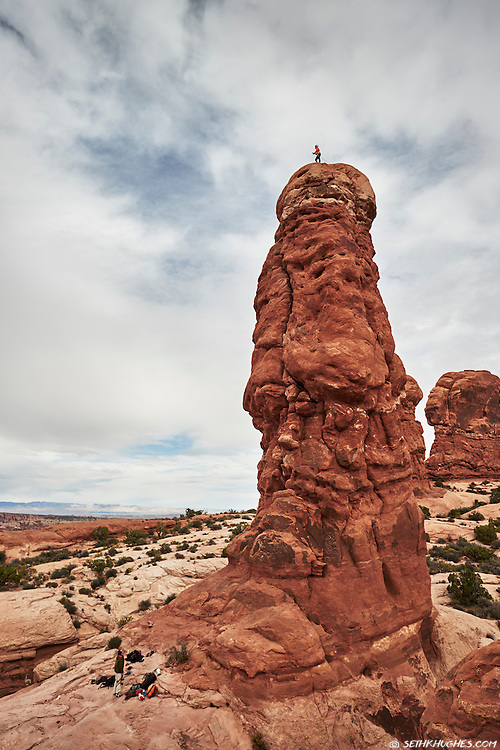 Rock climbing on Owl Rock tower in Arches National Park, Moab, Utah.