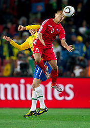 Lucio of Brazil vs Jong Tae Se of Korea during the 2010 FIFA World Cup South Africa Group G match between Brazil and North Korea at Ellis Park Stadium on June 15, 2010 in Johannesburg, South Africa. Brazil defeated Korea 2-1. (Photo by Vid Ponikvar / Sportida)