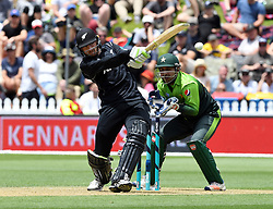 New Zealand's Martin Guptill hits a four in front of Pakistan's Sarfraz Ahmed in the first one day cricket international at the Basin Reserve, Wellington, New Zealand, Saturday, January 06, 2018. Credit:SNPA / Ross Setford  **NO ARCHIVING**
