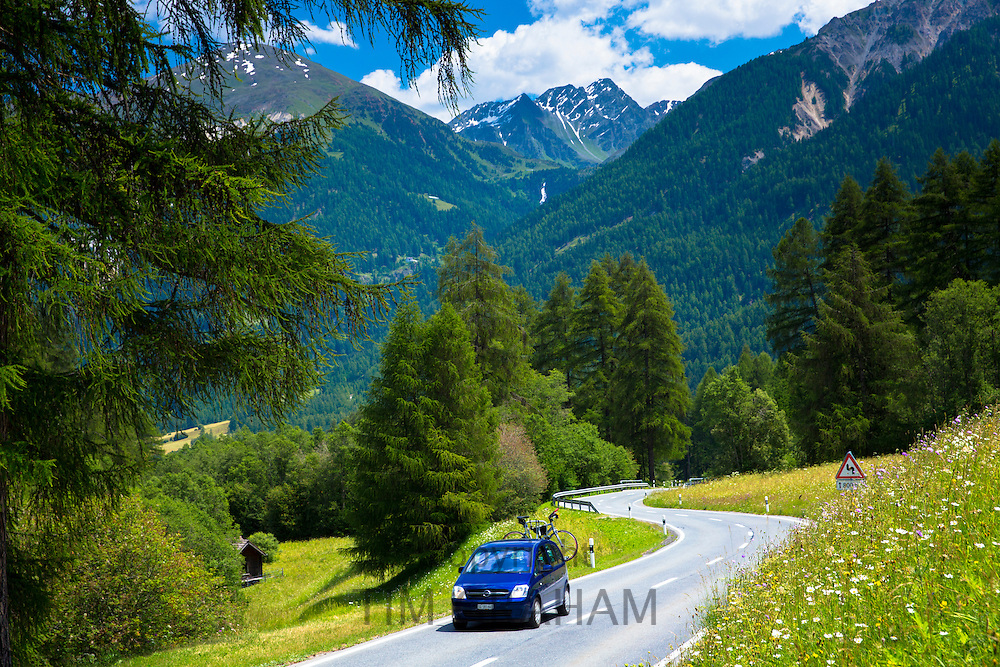 Car with bicycle rack on touring holiday in the Swiss Alps, Swiss National Park, Switzerland